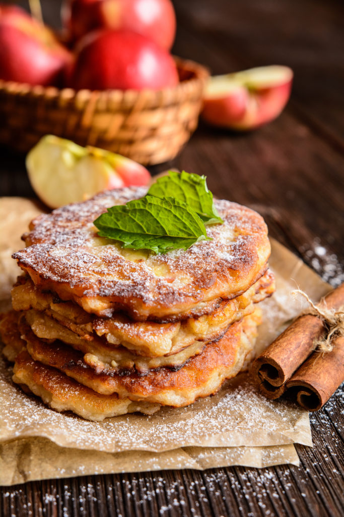 Sweet pancakes made of apple, curd and cinnamon