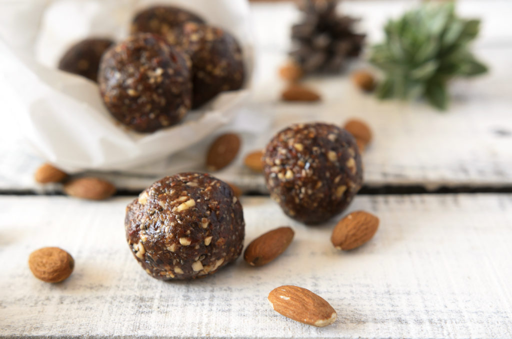 Vegan sweet delicious almond cocoa balls healthy and tasty food on wooden table
